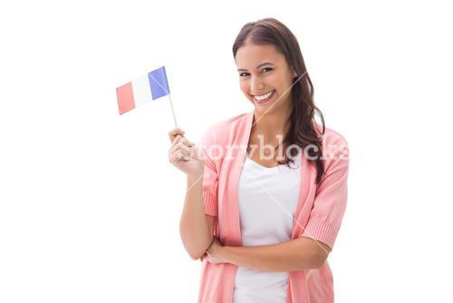 Pretty brunette smiling and holding french flag