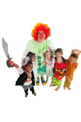 Funny clown with children in fancy dress