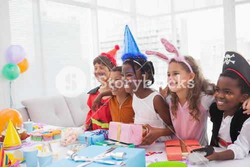 Happy children at fancy dress birthday party