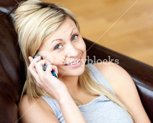 Lively woman using a phone