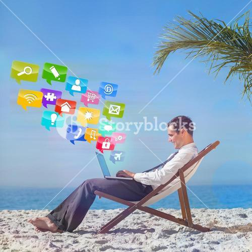 Composite image of young businessman on his beach chair using his laptop