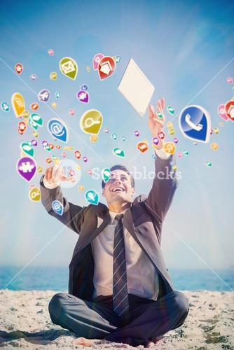 Composite image of victorious young businessman juggling with his tablet