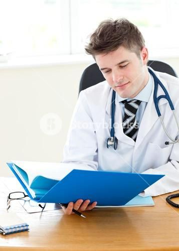 Handsome young doctor holding a folder