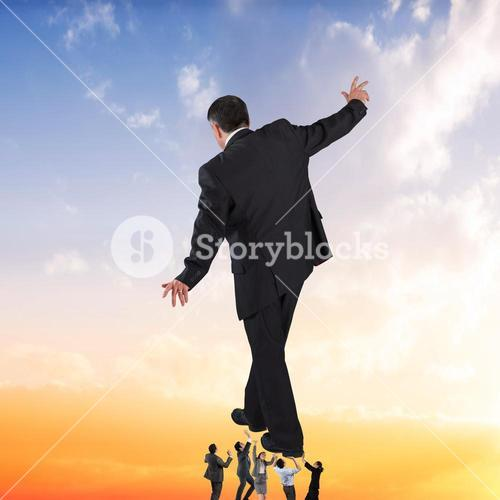 Composite image of business team supporting boss