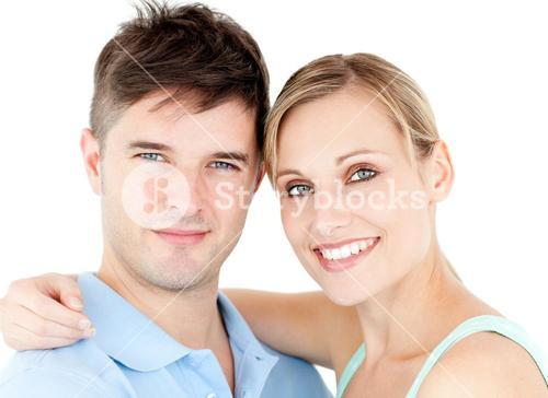 Portrait of a smiling young couple against white background