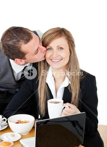Young businessman kissing his delighted girlfriend