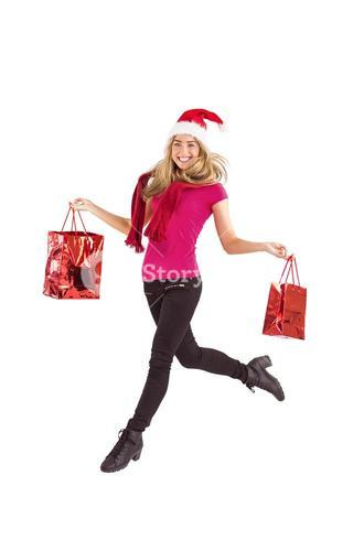 Festive blonde carrying gift bags
