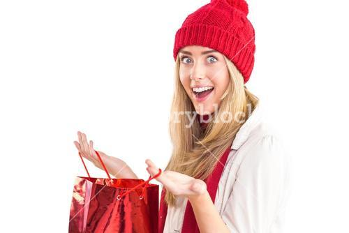 Happy blonde opening gift bag