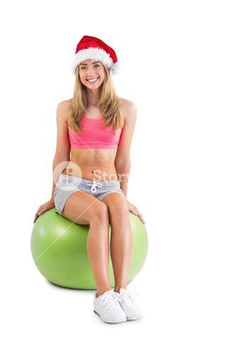 Festive fit blonde sitting on exercise ball