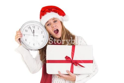 Festive blonde showing a clock and gift