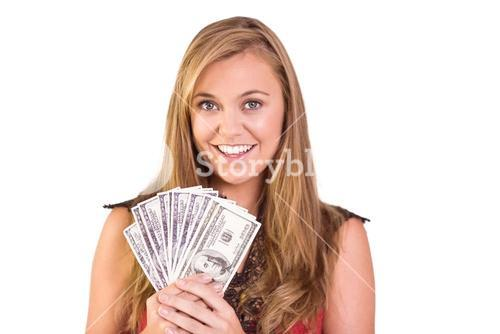 Pretty blonde showing wad of cash