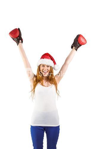 Festive redhead cheering with boxing gloves