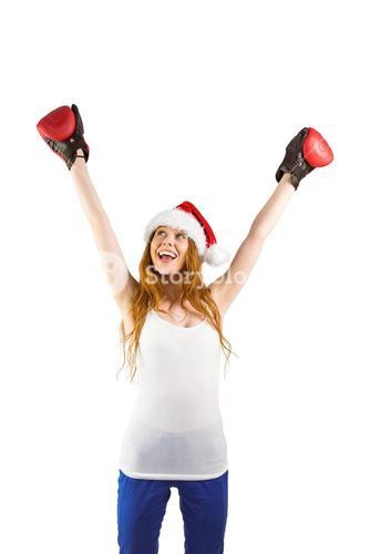 Festive redhead cheeering with boxing gloves