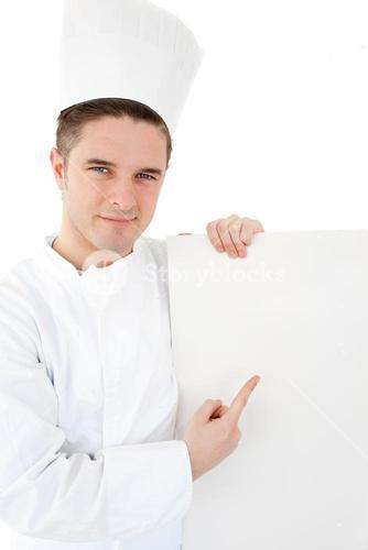 Confident young cook showing on a white paper against white background