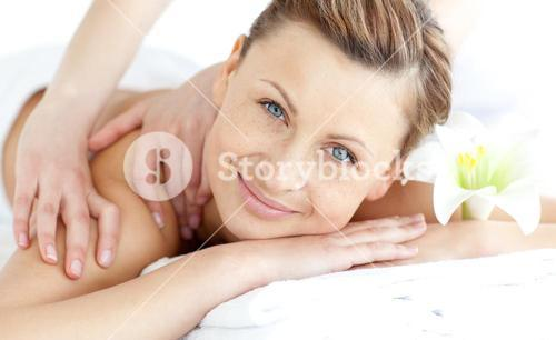 Delighted woman enjoying a back massage