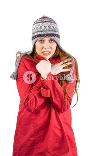 Cold redhead wearing coat and hat