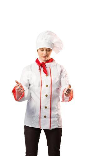 Pretty chef standing with hands out