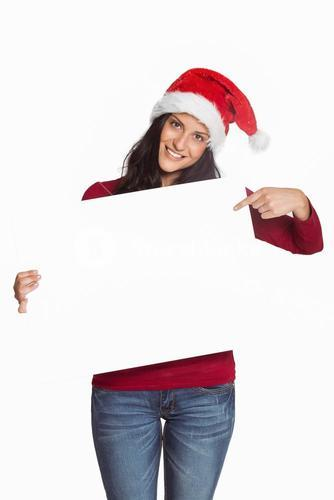 Woman pointing at white sign