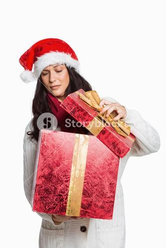Shocked woman opening christmas present