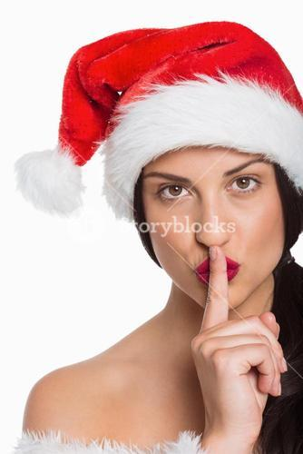 Woman with finger against lips