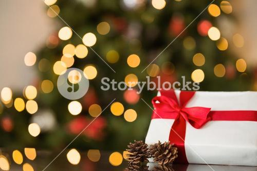 Focus on christmas gift and pine cone