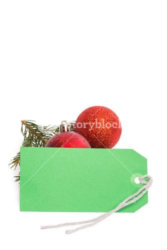 Green tag with christmas decorations