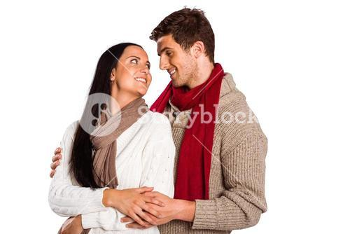 Young couple smiling and hugging