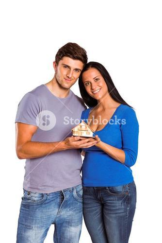Young couple holding a model house