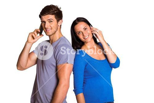 Young couple talking on their phones