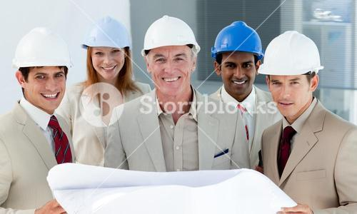 Architects with hardhats in a building site