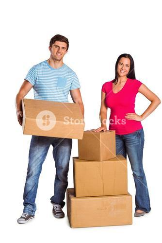 Young couple with moving boxes
