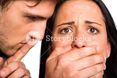Man covering his girlfriends mouth