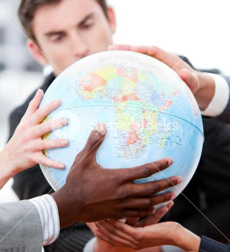 Close up of a business team holding a terrestrial globe