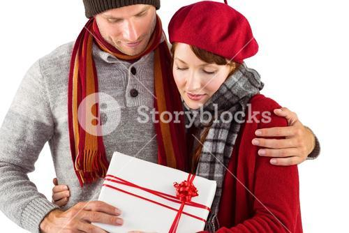 Couple smiling and holding gift
