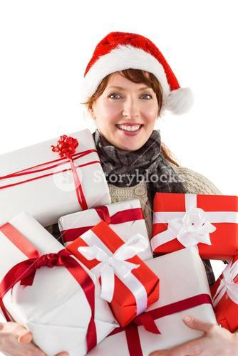 Woman holding lots of presents