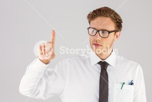 Geeky businessman smiling and pointing
