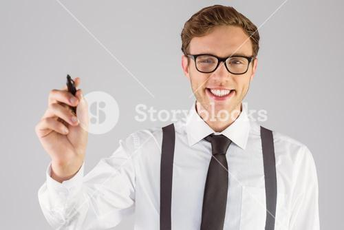 Geeky businessman writing with marker