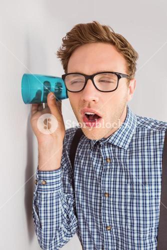 Geeky businessman eavesdropping with cup
