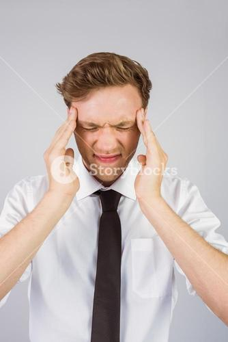 Young businessman getting a headache