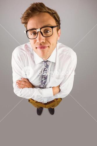 Young geeky businessman looking at camera