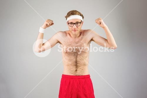 Geeky shirtless hipster flexing biceps