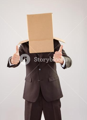 Anonymous businessman with thumbs up