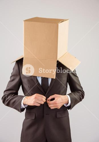 Anonymous businessman buttoning his jacket
