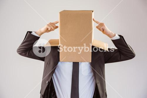 Anonymous businessman pointing to box