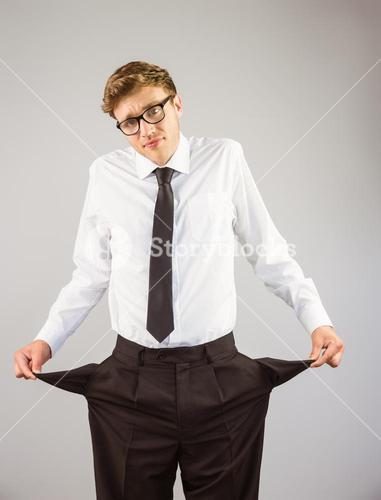 Geeky businessman showing his empty pockets
