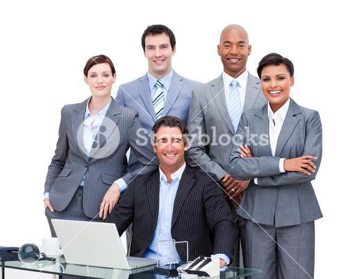 Diverse business people looking at the camera with a laptop