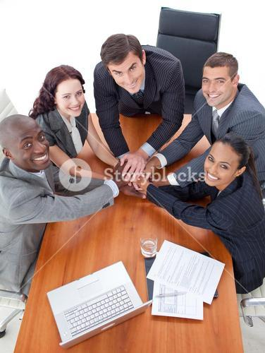 Smiling business team working together