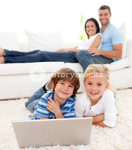 Loving family using a laptop in the living room