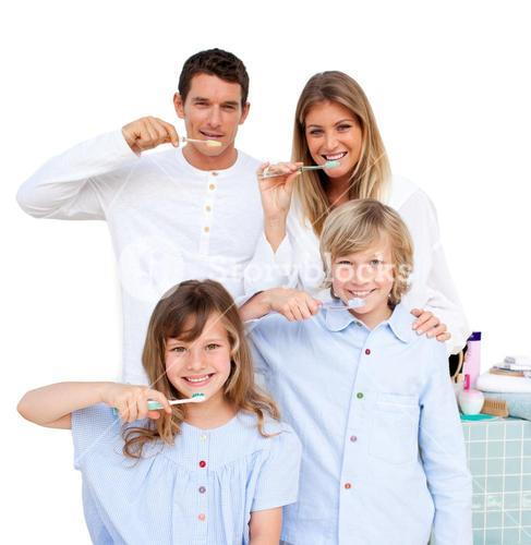 Smiling young family brushing their teeths