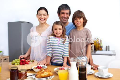 Portrait of a happy family preparing food